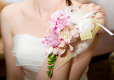 Wedding bouquet of orchids and roses in hand Royalty Free Stock Image