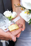Wedding bouquet and padlock Royalty Free Stock Image