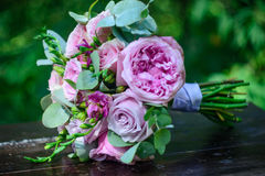 Wedding bouquet. Of pale pink roses with green leaves Stock Photography