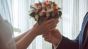 Wedding bouquet pass each other. The husband and the bride gift Royalty Free Stock Photos