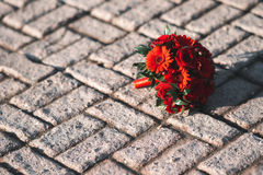 Wedding bouquet on the pavement. Red flowers Royalty Free Stock Photos