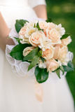 Wedding bouquet from peach-colored roses. And alstroemeria Stock Image