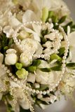Wedding bouquet and pearls Royalty Free Stock Photo