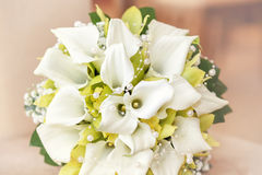 Wedding bouquet with pearls, orchid and calla. With shallow focus in pastel colors Royalty Free Stock Photography