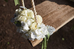 Wedding bouquet of peonies lying on a swing decorated with fresh. Flowers Royalty Free Stock Photos