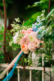 Wedding bouquet of peonies on a metal fence. Wedding in Monteneg Royalty Free Stock Photos