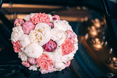 Wedding bouquet with peony. On dark piano Royalty Free Stock Images