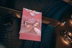 Wedding bouquet with peony. Wedding Invitation cart on piano Stock Image