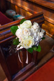 Wedding Bouquet on Pews Royalty Free Stock Photo