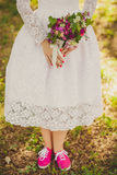 Wedding  bouquet. Wedding bouquet with pink flowers in the hands of the bride, Bride in pink sneakers Stock Photo