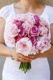 Wedding bouquet with pink peonies, carnations and roses Stock Photo