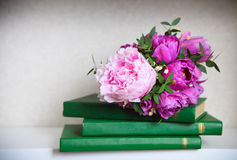 Wedding bouquet of a pink  peonies, tulips and lily of the valle Stock Images