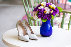 Wedding bouquet of pink and purple flowers and shoes Royalty Free Stock Photography