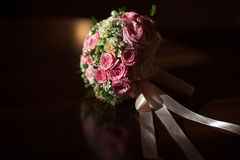 Wedding bouquet of pink roses on a black background Royalty Free Stock Images