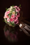 Wedding bouquet of pink roses on a black background Stock Photo