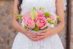 Wedding bouquet of pink roses and leaves Stock Images