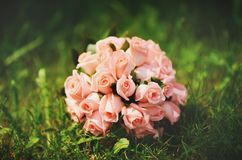 Wedding bouquet of pink roses. Wedding bouquet made of pink roses on grass Royalty Free Stock Image