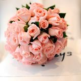 Wedding bouquet of pink roses. Stock Photos