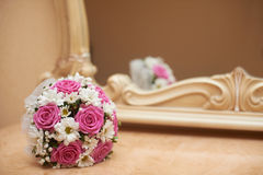 Wedding Bouquet of pink roses and white daisies. The Wedding Bouquet of pink roses and white daisies Royalty Free Stock Image
