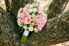 Wedding bouquet with pink roses on wooden bachground Stock Photos