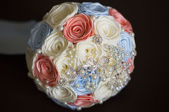 Wedding bouquet of pink, white, blue brooches. Rhinestones, pearls and ribbons Stock Photos