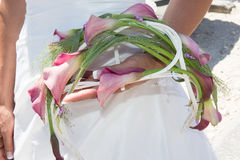 Wedding bouquet with pink and white flowers in hands of the bride Stock Images