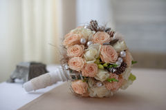 Wedding bouquet of  pink and white roses with cones Stock Photo