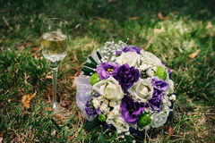Wedding bouquet of pink and white roses lying on Stock Photo
