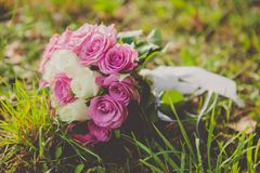 Wedding bouquet of pink and white roses lying on Royalty Free Stock Photo