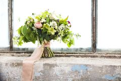 Wedding bouquet of pink and white roses. On the window of jld greenhouse Stock Image