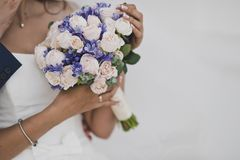 Wedding bouquet in the process of celebration. A bouquet of flowers in hands of bride at the wedding Royalty Free Stock Photography