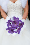 Wedding bouquet of purple orchids Stock Photos