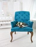 Wedding bouquet with ranunculus on the blue armchair Stock Photos