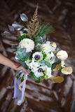 Wedding bouquet with ranunculus, freesia, roses and white anemon Royalty Free Stock Images