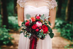 Wedding bouquet with red flowers Stock Photos