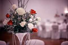 Wedding bouquet with red rose on the table Royalty Free Stock Photos