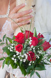Wedding bouquet of red roses. Wedding bouquet of roses and hand of the bride Stock Photos