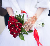 Wedding bouquet with red roses, arms, mehndi. Wedding bouquet with red roses, arms Stock Photo