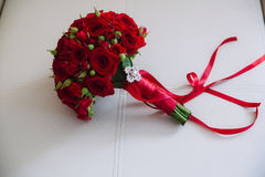 Wedding bouquet with red roses. Bride`s flowers on white background. Beautiful wedding bouquet. Bride`s flowers Stock Photo