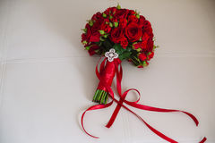 Wedding bouquet with red roses. Bride`s flowers on white background. Beautiful wedding bouquet. Bride`s flowers Stock Photography