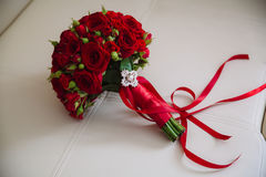 Wedding bouquet with red roses. Bride`s flowers on white background. Beautiful wedding bouquet. Bride`s flowers Stock Photos