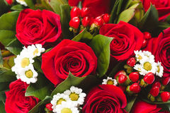 Wedding bouquet of red roses and dasies. Top view selective focus macro shot with shallow DOF.  Royalty Free Stock Photo
