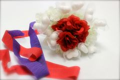 Wedding Bouquet. Red roses embedded in a bouquet of white hearts with red and purple streamers Stock Photography