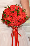 Wedding bouquet of red roses in the hands  bride. Wedding bouquet of red roses in the hands of the bride Royalty Free Stock Image
