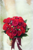 Wedding bouquet of red roses. And leaves Royalty Free Stock Image