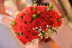 Wedding bouquet of red roses. And leaves Stock Photography