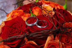 Wedding bouquet red roses. And rings Stock Images