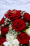 Wedding bouquet red roses. With rings Stock Photos