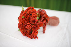 Wedding bouquet of red roses. On the table covered with white tablecloth Royalty Free Stock Photos