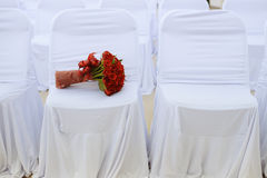 Wedding bouquet. Of red roses on white chair Stock Photos